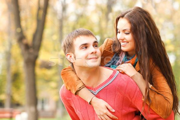Portrait of couple enjoying golden autumn fall season Stock photo © dashapetrenko