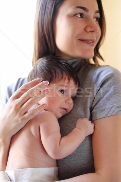 Happy smiling mother with baby Stock photo © dashapetrenko