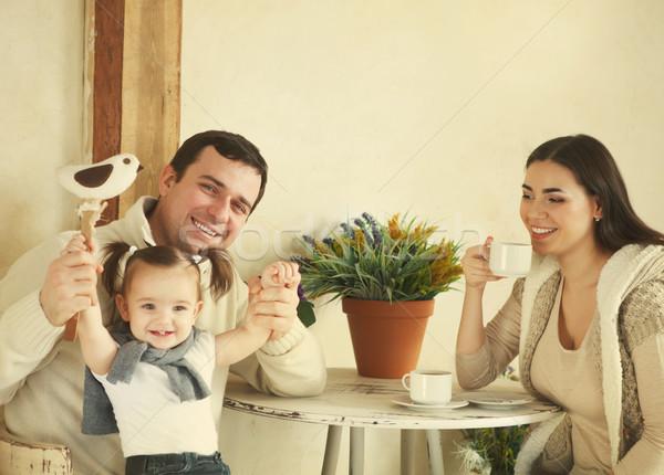 Boldog család egyéves kislány iszik kávé bent Stock fotó © dashapetrenko