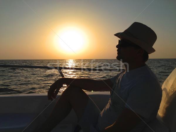 Сток-фото: расслабляющая · человека · сидят · лодка · парусного · океана