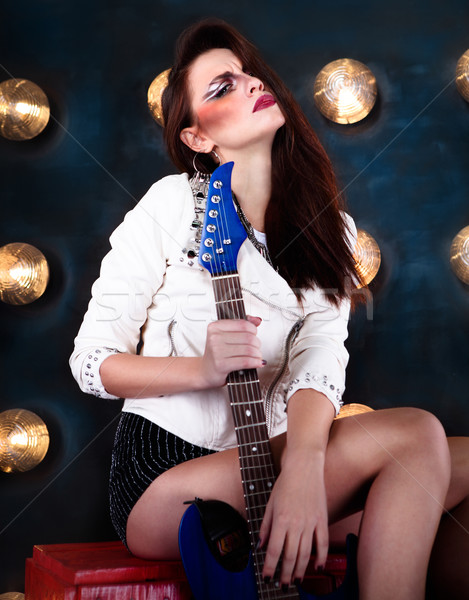 Attractive punk girl with cool make up holding guitar Stock photo © dashapetrenko