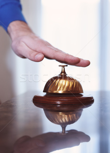Hand of a man using a hotel bell  Stock photo © dashapetrenko