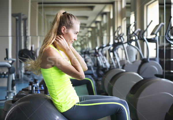 Side view of young fit woman doing sit-ups on exercise ball  Stock photo © dashapetrenko