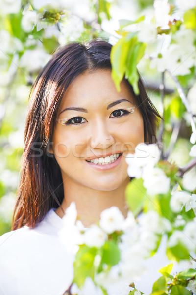 Happy smiling young girl in spring  garden Stock photo © dashapetrenko