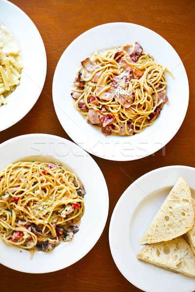 Various kind of Italian pasta spaghetti with tomato, proshutto,  Stock photo © dashapetrenko