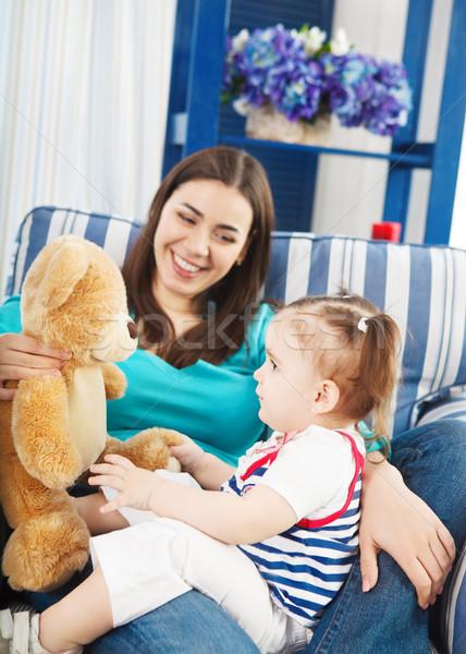 Boldog mosolyog anya egyéves baba kislány Stock fotó © dashapetrenko