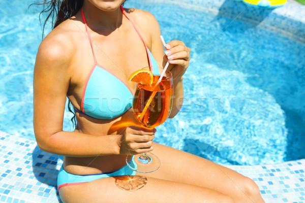 Real female beauty enjoying her summer vacation at swimming pool Stock photo © dashapetrenko