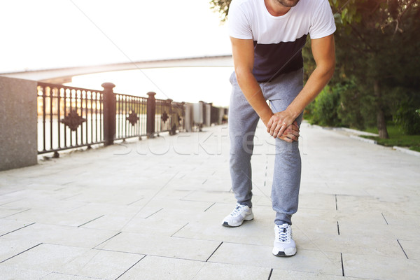 Man out jogging with knee pain  Stock photo © dashapetrenko
