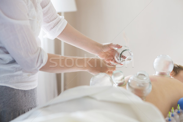 Young woman getting treatment at medical clinic Stock photo © dashapetrenko