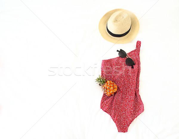 Summer vacation concept with swimwear sunglasses hat and pineapp Stock photo © dashapetrenko