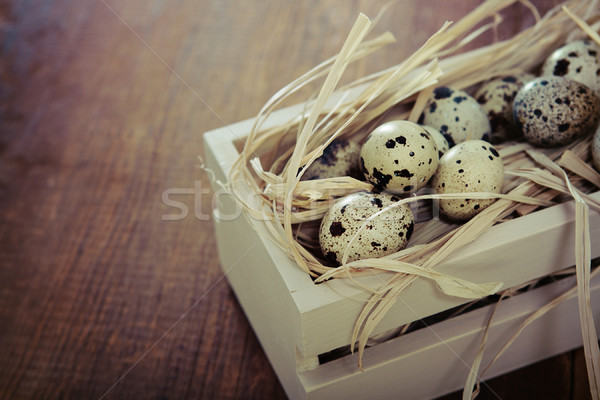 Spotted eggs on wooden background Stock photo © dashapetrenko