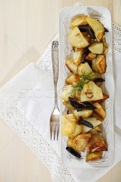 Potato salad with olives, onion, dill and olive oil Stock photo © dashapetrenko