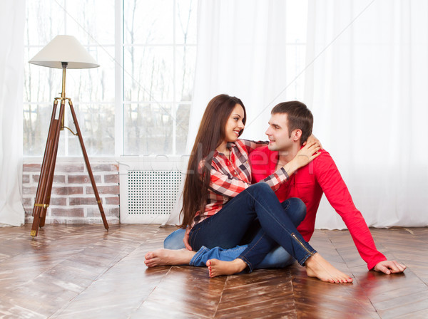 Couple at home relaxing on the floor Stock photo © dashapetrenko