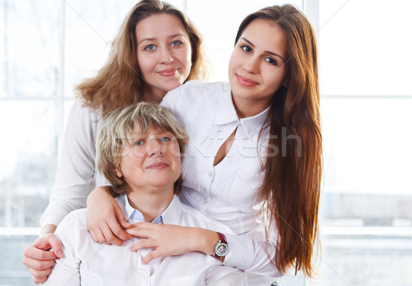 Portrait of a mature mother and adult daughter and teen granddau Stock photo © dashapetrenko