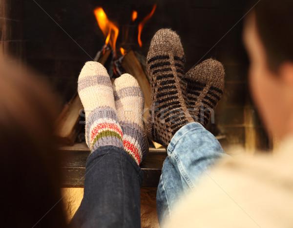 Lábak pár zokni kandalló téli idény közelkép Stock fotó © dashapetrenko