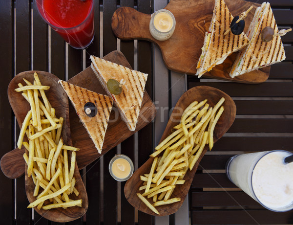 куриные клуба Бутерброды картофель фри таблице сока Сток-фото © dashapetrenko