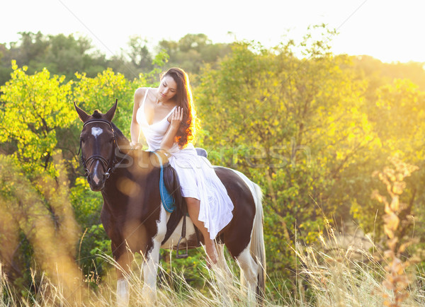 Young woman riding a horse Stock photo © dashapetrenko