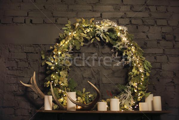 Natal coroa acima parede de tijolos luzes velas Foto stock © dashapetrenko