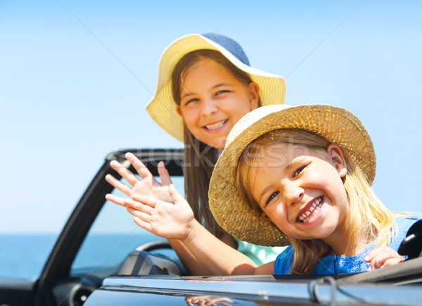Portrait of smiling two children at beach in the car. Holiday an Stock photo © dashapetrenko