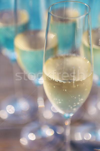 Champagne glasses on wooden background near pool Stock photo © dashapetrenko