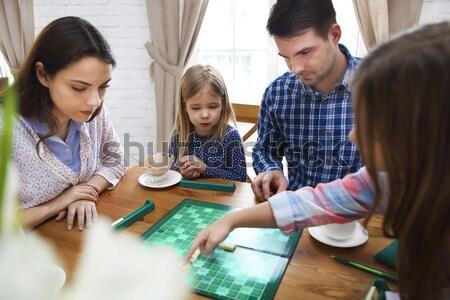 Boldog fiatal család társasjáték kettő gyerekek Stock fotó © dashapetrenko