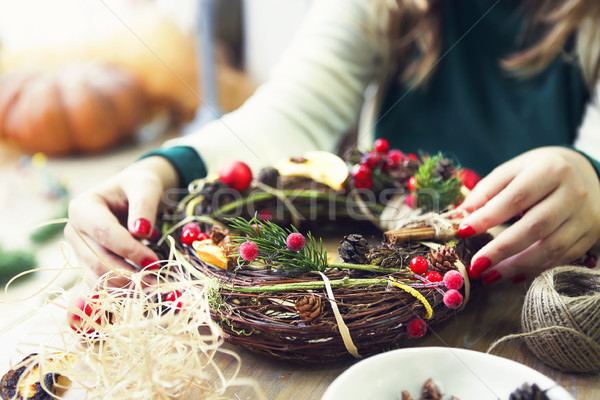 Christmas wreath in young womans hands Stock photo © dashapetrenko