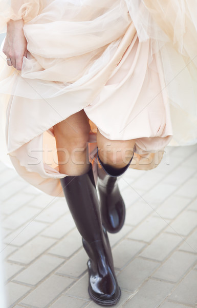 Bride wearing rubber boots outside  Stock photo © dashapetrenko