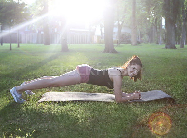 Stretching woman in outdoor exercise smiling happy doing stretch Stock photo © dashapetrenko