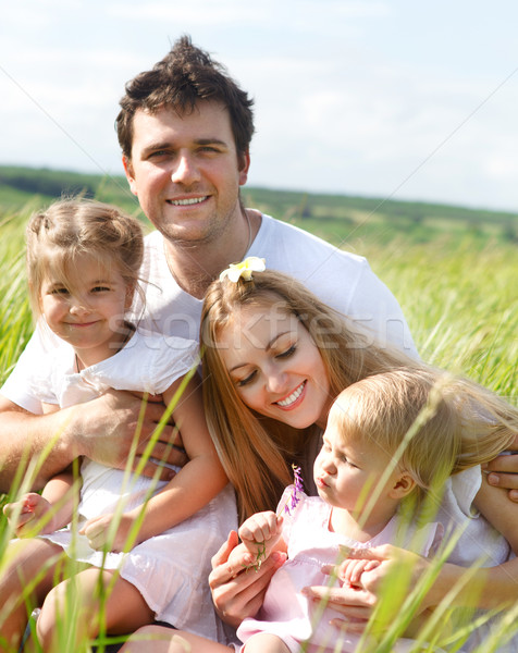 Happy young family with two children  Stock photo © dashapetrenko