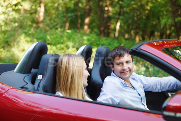 Couple in red cabriolet in a sunny day Stock photo © dashapetrenko