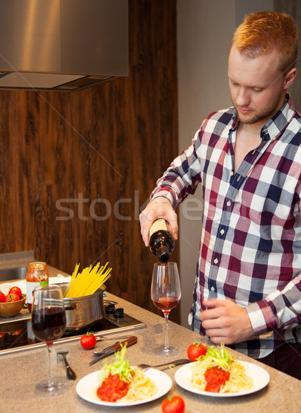 Handsome man cooking at home preparing pasta  Stock photo © dashapetrenko
