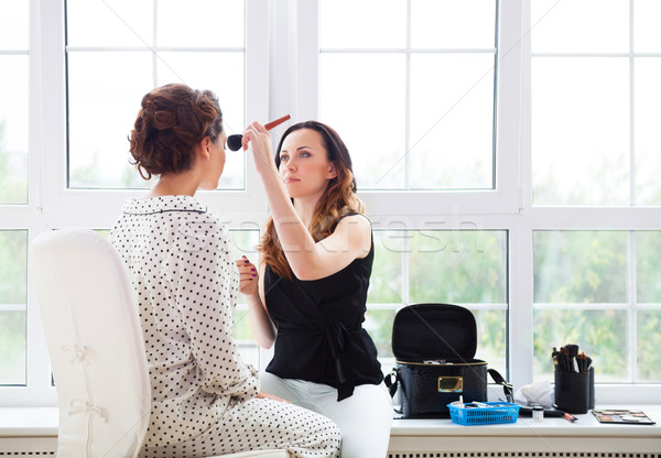 Make-up artist doing make up for young beautiful bride  Stock photo © dashapetrenko