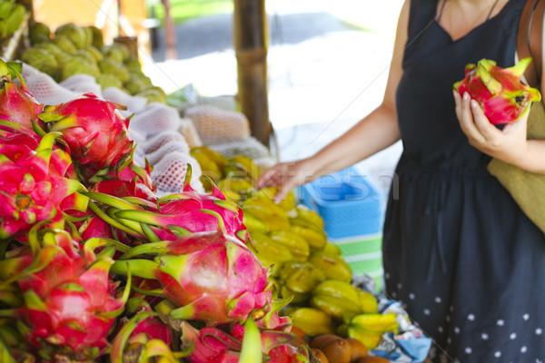 Woman choosing fruits in the open air fruit market  Stock photo © dashapetrenko