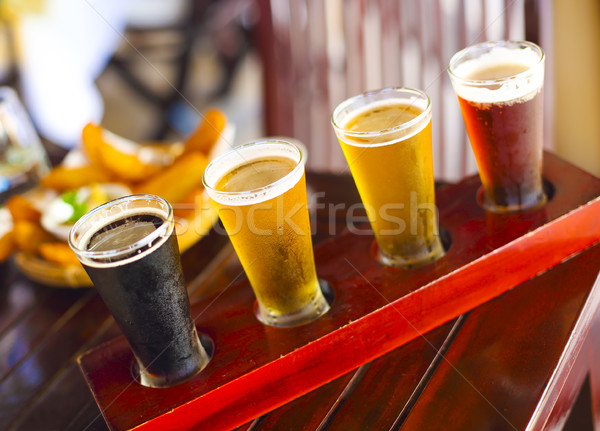 Four sorts of beer. Beer tasting. Ale, porter, lager, pilsner Stock photo © dashapetrenko