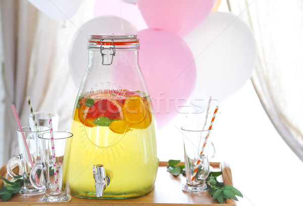 Citrus homemade lemonade in a beverage dispencer Stock photo © dashapetrenko