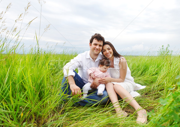 Happy young family with baby girl  Stock photo © dashapetrenko