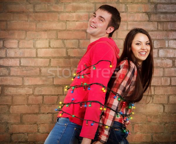 Boldog fiatal pér téglafal girland vicces nő Stock fotó © dashapetrenko
