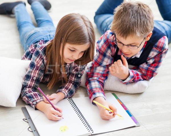 Two little kids drawing with crayons Stock photo © dashapetrenko