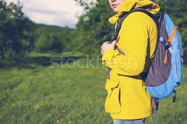 Side view of young man with backpack hiking  Stock photo © dashapetrenko