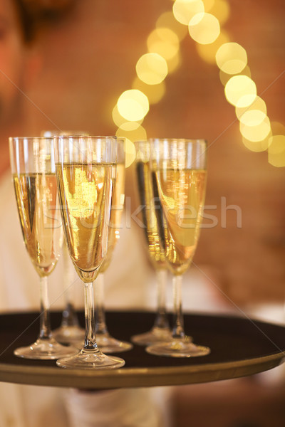 Champagne glasses on tray. Party and event concept Stock photo © dashapetrenko