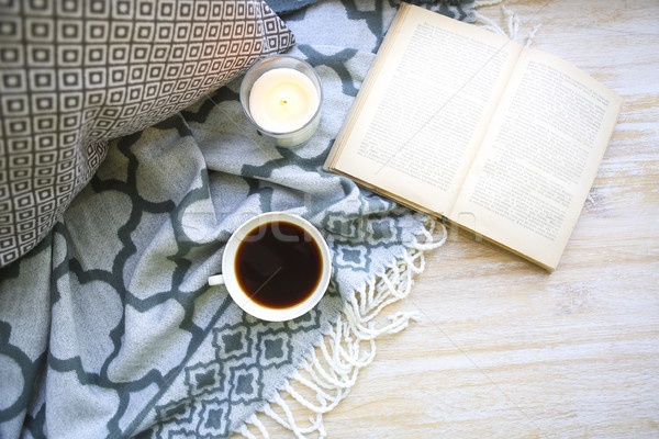 Cup of coffee, candle and book on the floor Stock photo © dashapetrenko