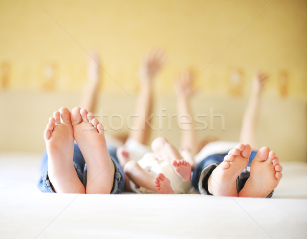 Sweet family in bed. Three sisters, close up on feet Stock photo © dashapetrenko