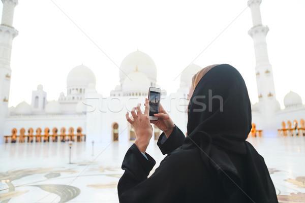 Femme photos mosquée téléphone portable coucher du soleil Photo stock © dashapetrenko