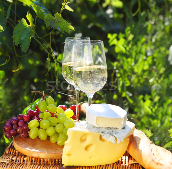 Various sorts of cheese, bread, grapes and two glasses of the wh Stock photo © dashapetrenko
