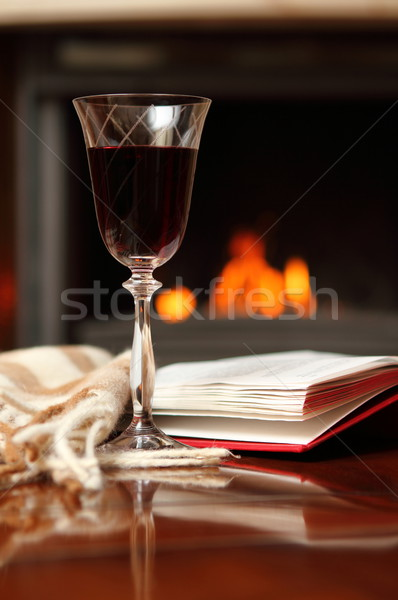 Red wine by the fireplace Stock photo © dashapetrenko