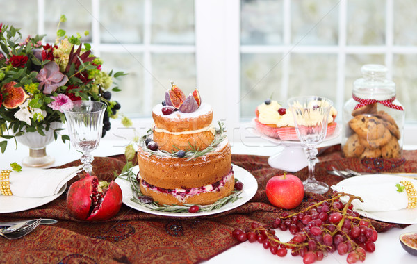 Dessert table for a wedding. Cake, cupcakes, sweetness and flowe Stock photo © dashapetrenko