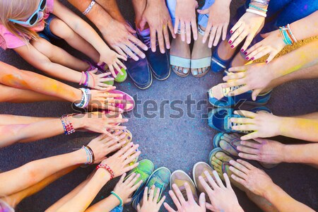 Friends putting their feet together in a sign of unity and teamw Stock photo © dashapetrenko