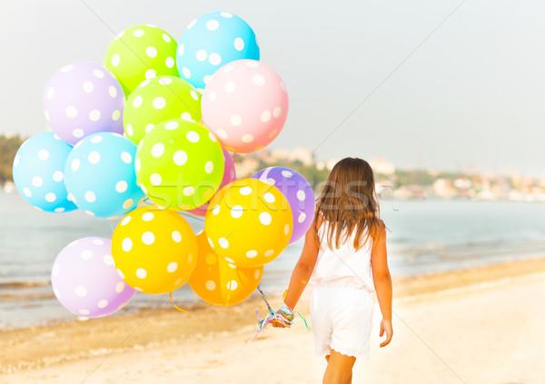 Stockfoto: Meisje · spelen · ballonnen · strand · gelukkig · meisje