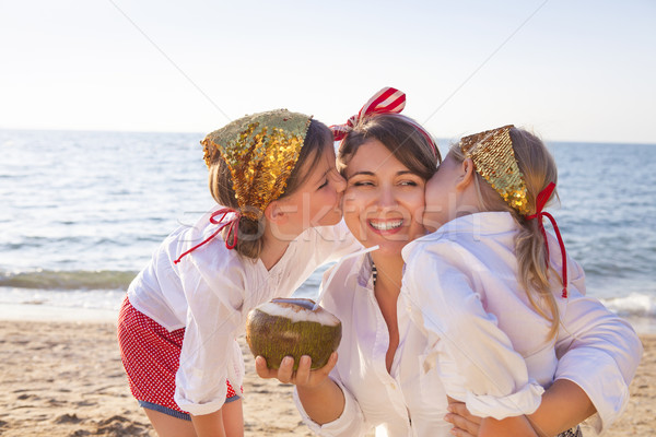 счастливым матери прелестный питьевой кокосовое молоко пляж Сток-фото © dashapetrenko