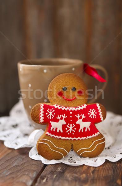 Smiling christmas gingerbread men on wooden background.  Stock photo © dashapetrenko